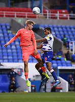 7th July 2020; Madejski Stadium, Reading, Berkshire, England; English Championship Football, Reading versus Huddersfield; Gabriel Osho of Reading competes for the ball with Karlan Grant of HuddersfieldAndy King of Huddersfield competes in the air with Andy Rinomhota of Reading