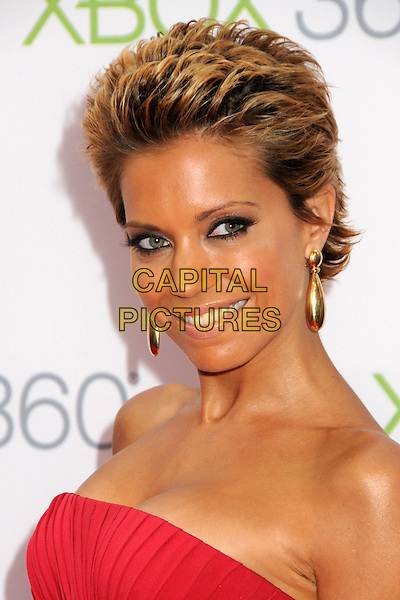 "SYLVIE VAN DER VAART.Xbox 360's ""Project Natal"" Premiere Party held at USC's Galen Center, Los Angeles, California, USA..June 13th, 2010.headshot portrait red strapless short hair gold earrings eyeliner make-up .CAP/ADM/BP.©Byron Purvis/AdMedia/Capital Pictures."