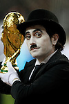 A man disguised as Charles (Charlotte) Chaplin holds a  mock World Cup trophy during UNICEF match. December, 29 2010. (ALTERPHOTOS/Alvaro Hernandez)