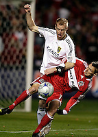 Real Salt Lake defender Nat Borchers (6) knocks Chicago Fire midfielder Chris Rolfe (17) sideways.  Real Salt Lake defeated the Chicago Fire in a penalty kick shootout 0-0 (5-4 PK) in the Eastern Conference Final at Toyota Park in Bridgeview, IL on November 14, 2009.