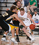 SPEARFISH, SD - DECEMBER 29:  Clay Pottorff #25 of Black Hills State drives on Cole Smith of UC-Colorado Springs during their game at the Perkins Basketball Classic Tuesday at the Donald E. Young Center in Spearfish, S.D. (Photo by Dick Carlson/Inertia