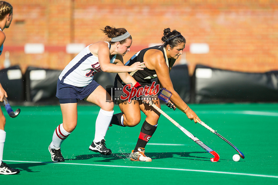 Anna Kozniuk (22) of the Wake Forest Demon Deacons fights for a loose ball with Natalie Barr (19) of the Liberty Flames at Kentner Stadium on September 13, 2013 in Winston-Salem, North Carolina.  The Demon Deacons defeated the Flames 3-2.  (Brian Westerholt/Sports On Film)