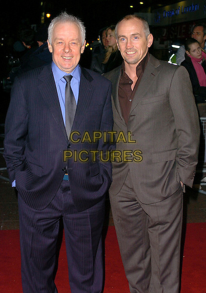 "JIM SHERIDAN & BARRY McGUIGAN.""Get Rich Or Die Tryin'"" UK film premiere at Empire ELicester Square, London, UK..January 17th, 2006.Ref: CAN.half length blue grey gray suit jacket hands in pockets.www.capitalpictures.com.sales@capitalpictures.com.©Capital Pictures"