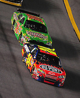 Jul. 5, 2008; Daytona Beach, FL, USA; NASCAR Sprint Cup Series driver Jeff Gordon (24) leads Kyle Busch (18) during the Coke Zero 400 at Daytona International Speedway. Mandatory Credit: Mark J. Rebilas-
