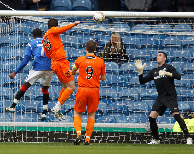 Gavin Gunning rises to beat Maurice Edu in the air to score for Dundee Utd
