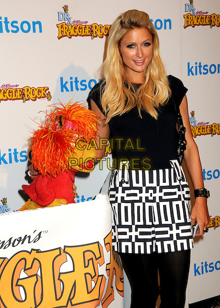 RED FRAGGLE & PARIS HILTON.The Dr. Romanelli Fraggle Rock Clothing Collaboration & The Anita Ko Fraggle Rock Costume Jewelry Collection in Partnership with Volkswagen Host A Toy Drive to benefit the L.A. Mission held at Kitson, West Hollywood, California, USA..December 9th, 2009.half length black white skirt top dress pattern print muppet  .CAP/ADM/BP.©Byron Purvis/AdMedia/Capital Pictures.