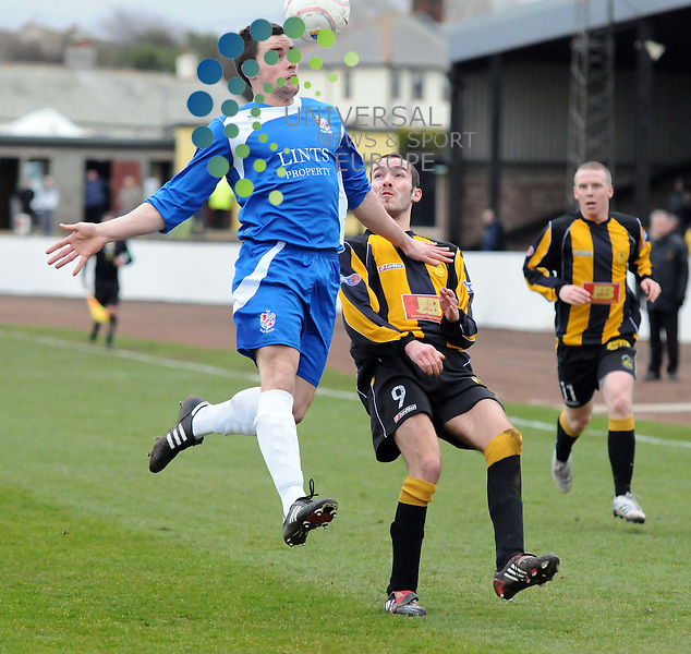 Armstrong clears from Gribbon during the Berwick v Cowdenbeath league match
