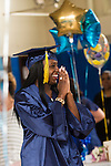 WATERBURY, CT- 8 June 2016-060816EC02-  Emoni Sunday celebrates as she walks down the aisle to get her diploma from The State Street School in Waterbury. Five seniors received their diplomas inside the Police Activity League building. Erin Covey Republican-American