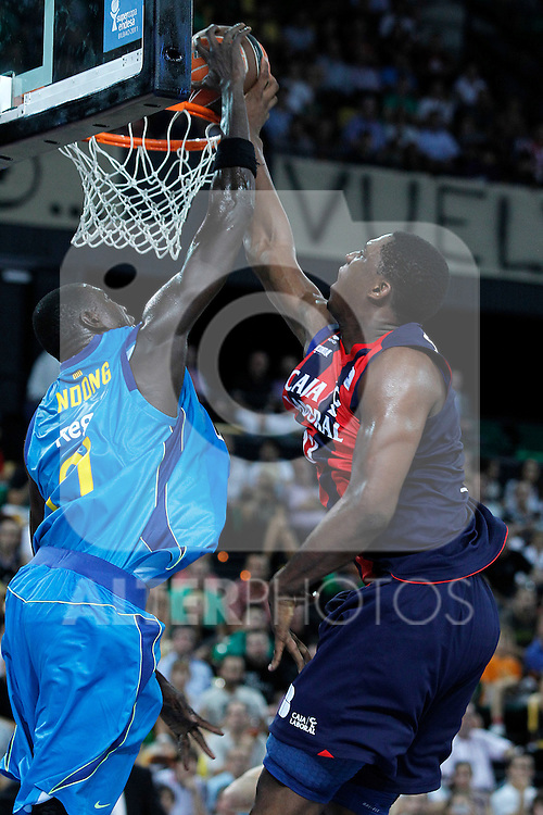 Caja Laboral's Kevin Seraphin (r) and FC Barcelona Regal's Boniface Ndong during Supercopa ACB Final match.October 1,2011. (ALTERPHOTOS/Acero)