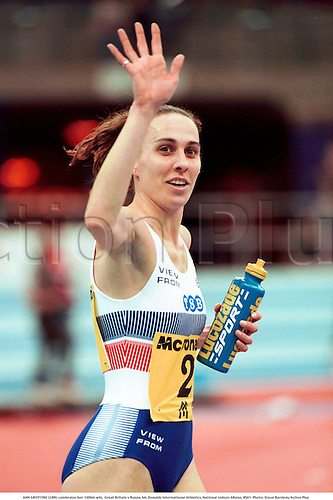 ANN GRIFFITHS (GBR) celebrates her 1500m win,  Great Britain v Russia, Mc Donalds International Athletics, National Indoor ARena, 9501. Photo: Steve Bardens/Action Plus...celebration.drinking.Lucozade.1995.woman.portrait.track and field.female