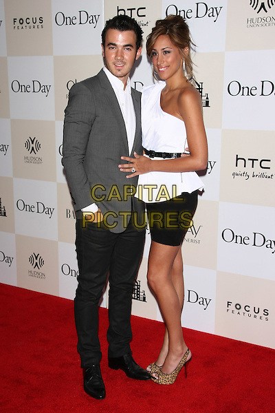 "Kevin & Danielle Jonas.The New York Premiere of ""One Day"" held at AMC Loews Lincoln Square Cinemas, New York, NY, USA..August 8th, 2011.full length grey gray suit jacket white shirt white one shoulder top black skirt married husband wife.CAP/LNC/TOM.©LNC/Capital Pictures."