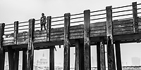 Person on a pier on the banks of the River Thames, South Bank, London, England