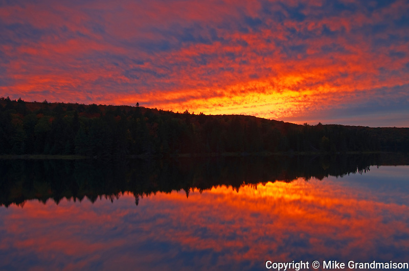 Sunset reflected in Brewer Lake<br /> Algonquin Provincial Park<br /> Ontario<br /> Canada