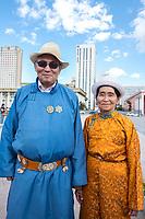 Mongolia, Ulaanbaatar. Sukhbaatar Square, man and woman.