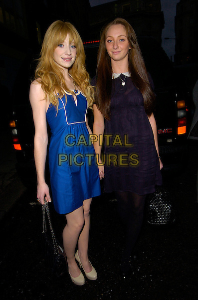 NICOLA ROBERTS (Girls Aloud) & her sister.At the Jelly Pong Pong & Nicola Roberts Cosmetics Launch, Sketch, London, England, January 18th 2007..make-up full length blue dress cream platform shoes bag siblings family.CAP/CAN.©Can Nguyen/Capital Pictures