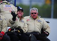 Nov. 11, 2011; Pomona, CA, USA; NHRA safety safari members during qualifying at the Auto Club Finals at Auto Club Raceway at Pomona. Mandatory Credit: Mark J. Rebilas-.