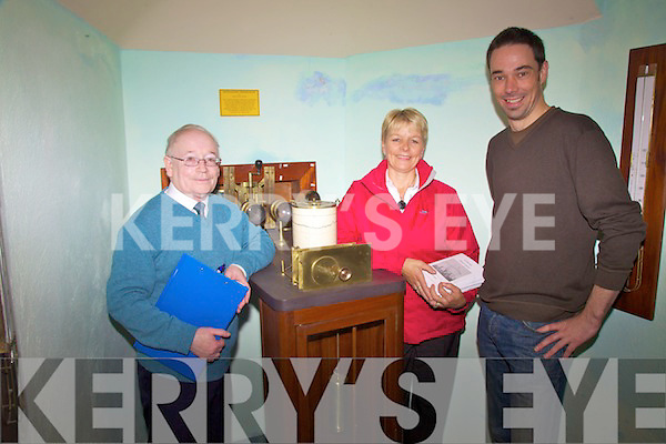 Getting a tour of Westwood House at the Valentia Observatory in Cahersiveen on Saturday last were l-r; Paud Mahoney(Retired Met Service Cahersiveen), Mary O'Sullivan(Met Service Valentia Observatory)& Rowan Fealy -Tralee, pictured here  alongside a 'Photograph Thermograph' in the Observatory Museum one of the first three pieces of equipment used at the Valentia Station.