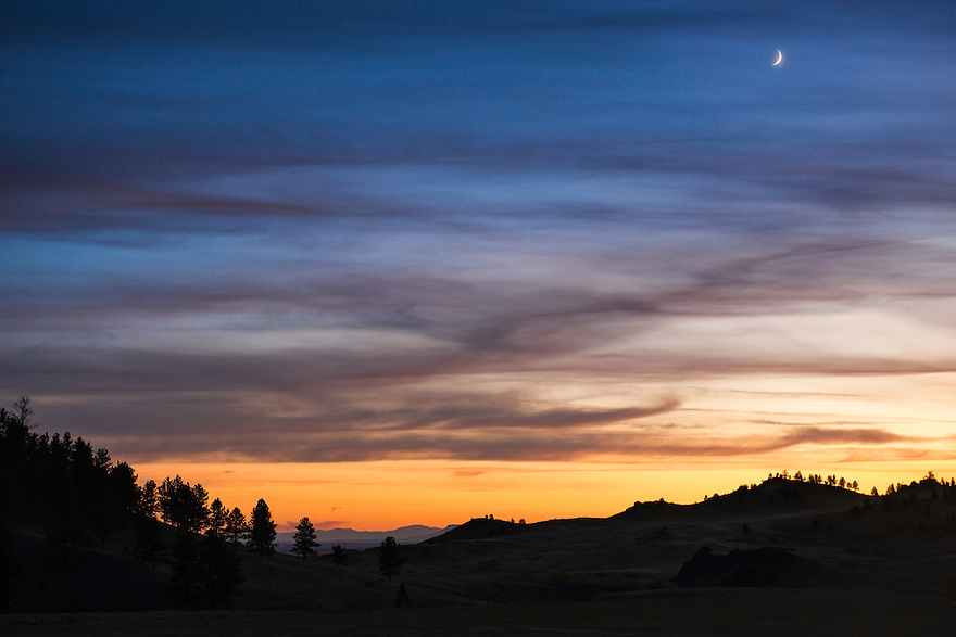 The moon rises over the Bear Paw Mountains near Big Sandy, Montana.