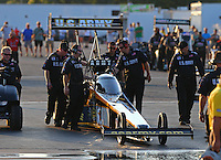 Aug 15, 2014; Brainerd, MN, USA; Crew members wait with NHRA top fuel dragster driver Tony Schumacher during qualifying for the Lucas Oil Nationals at Brainerd International Raceway. Mandatory Credit: Mark J. Rebilas-