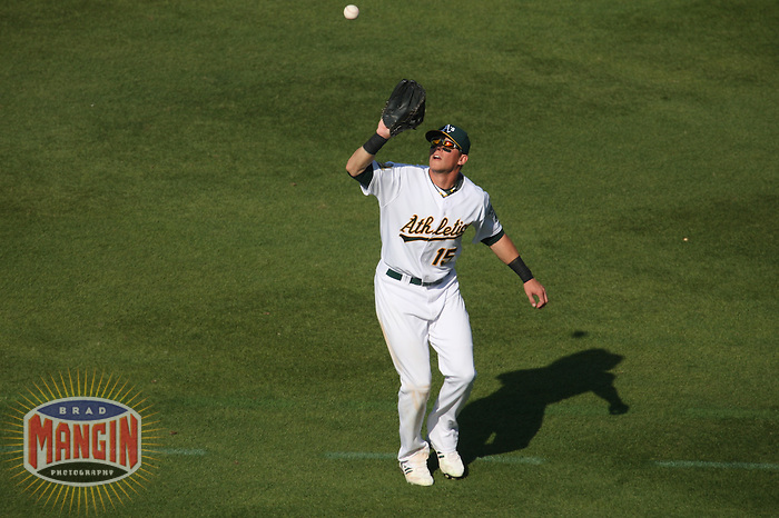 OAKLAND, CA - SEPTEMBER 14:  Ryan Sweeney of the Oakland Athletics catches a fly ball in right field during the game against the Texas Rangers at the McAfee Coliseum in Oakland, California on September 14, 2008.  The Athletics defeated the Rangers 7-4.  Photo by Brad Mangin