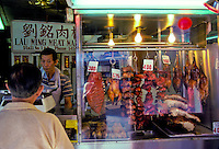 Man selling meat in Chinatown, Oahu, Hawaii