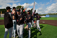Batavia Muckdogs Troy Johnston (27) and Dalvy Rosario (17) high five teammates after clinching the Pinckney Division Title during a NY-Penn League game against the Auburn Doubledays on September 2, 2019 at Falcon Park in Auburn, New York.  Batavia defeated Auburn 7-0 to clinch the Pinckney Division Title.  (Mike Janes/Four Seam Images)