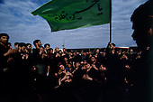"Tehran, Iran .June 7, 1989..Hundreds of thousands of mourners visit at the grave site for the Grand Ayatullah Sayid Ruhullah Musawi Khomeini in the Beheht-E-Zahra cemetery. He died of heart attack on June 3, 1989...Khomeini was a senior Muslim cleric, Islamic philosopher and marja (religious authority), and the political leader of the 1979 Iranian Revolution that saw the overthrow of Mohammad Reza Pahlavi, the last Shah of Iran. Following the revolution, Khomeini became the country's Supreme Leader?the paramount political figure of the new Islamic Republic...Khomeini was a marja al-taqlid, (source of imitation) and important spiritual leader to many Shia Muslims. He was also an innovative Islamic political theorist, most noted for his development of the theory of velayat-e faqih, the ""guardianship of the jurisconsult (clerical authority)"". He was named Time's Man of the Year in 1979 and also one of Time magazine's 100 most influential people of the 20th century."