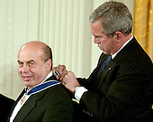"Washington, D.C. - December 15, 2006 -- Natan Sharansky  smiles as United States President George W. Bush fastens the the Presidential Medal of Freedom around his neck during a ceremony in the East Room of the White House on Friday, December 15, 2006.  The medal is the nation's highest civil award.  It may be awarded ""to any person who has made an especially meritorious contribution to (1) the security or national interests of the United States, or, (2) world peace, or (3) cultural or other significant public or private endeavors"".  Natan Sharansky's life is the story of good conquering evil and an illustration of the strength of the human spirit.  Imprisoned by the Soviet regime for his work to advance religious liberty and human rights, he spent nine years in the gulag.  Following his immigration to Israel, he served with distinction in that nation's government.  He remains a powerful champion of the principles that all people deserve to live in freedom and that the advance of liberty is critical to peace and security around the world.  The United States honors Natan Sharansky for his contributions to and sacrifices for the cause of democracy and freedom.<br /> Credit: Ron Sachs / CNP"