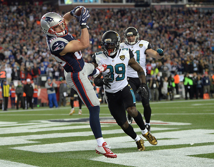 (Foxboro, MA, 01/21/18) New England Patriots wide receiver Danny Amendola, left, hauls in the game winning touchdown over Jacksonville Jaguars' Tashaun Gipson and Paul Posluszny during the fourth quarter of the AFC championship NFL football game at Gillette Stadium on Sunday, January 21, 2018. Photo by Christopher Evans