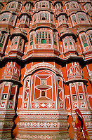 Palace of the Wind, Jaipur, India. Closeup of walls and windows. Architectural detail. Woman in sari walking by. ornamental architecture, ornate details. Jaipur Rajasthan India Asia.