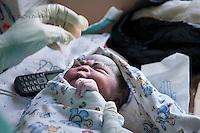 Newborn in the delivery room of the labor ward of Arua Hospital, Uganda.