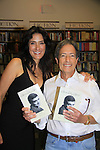 "Neurologist Howard Reiser poses with Another World's Alicia Coppola who speaks and signs her book ""Gracefully Gone"" - a fusion of two journals: her father Matthew L. Coppola Sr. and hers - on August 23, 2013 at Book Revue, Huntington, New York. (Photo by Sue Coflin/Max Photos)"