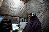 Fatima Abshir Mohammad, 19 years old, sound technician for RADIO BAY, voice of the Transitional federal Government works in the raidio's sound studio in Baidoa, Somalia on Wednesday January 03 2007.. Only a few days after the fall of the United Islamic Courts in Mogadishu, Ethiopian and Transitional Federal Government troops are patrolling the city and securing strategic locations..The people in Mogadishu appear confused and doubtful on t