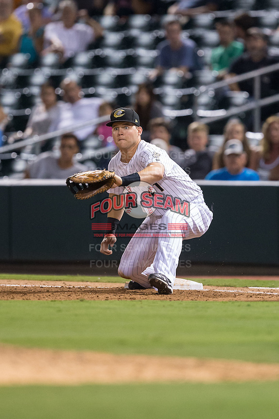Charlotte Knights first baseman Jerry Sands (41) stretches for a low throw during the game against the Pawtucket Red Sox at BB&T BallPark on July 6, 2016 in Charlotte, North Carolina.  The Knights defeated the Red Sox 8-6.  (Brian Westerholt/Four Seam Images)