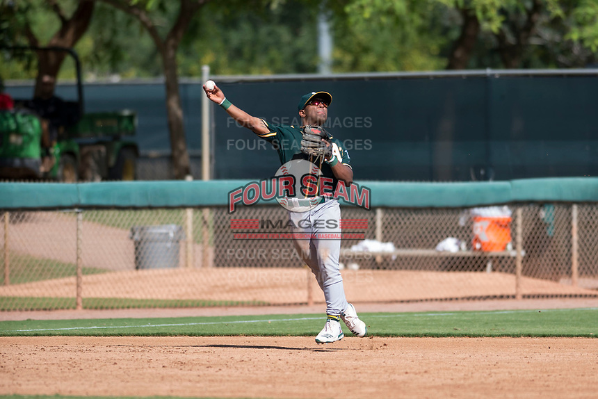 Oakland Athletics second baseman Cobie Vance (19) makes an off-balance throw to first base during an Instructional League game against the Los Angeles Dodgers at Camelback Ranch on October 4, 2018 in Glendale, Arizona. (Zachary Lucy/Four Seam Images)