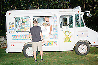 An ice cream truck serves at Londonderry Old Home Day in Londonderry, New Hampshire. Republican presidential candidate Dr. Ben Carson later showed up at the event to meet New Hampshire voters.