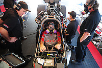 Jun. 2, 2012; Englishtown, NJ, USA: Crew members surround the car of NHRA top fuel dragster driver Steve Torrence as he warms up in the pits during qualifying for the Supernationals at Raceway Park. Mandatory Credit: Mark J. Rebilas-