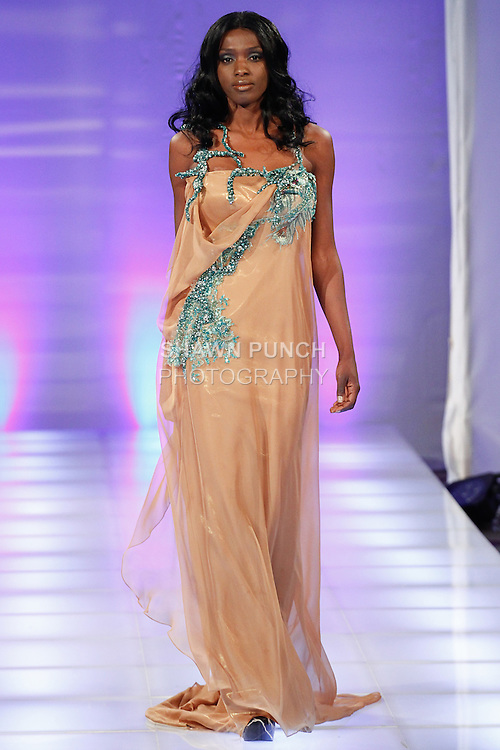 Model walks runway in an outfit from the Laila Wazna Couture collection fashion show, during Couture Fashion Week, September 8, 2013.