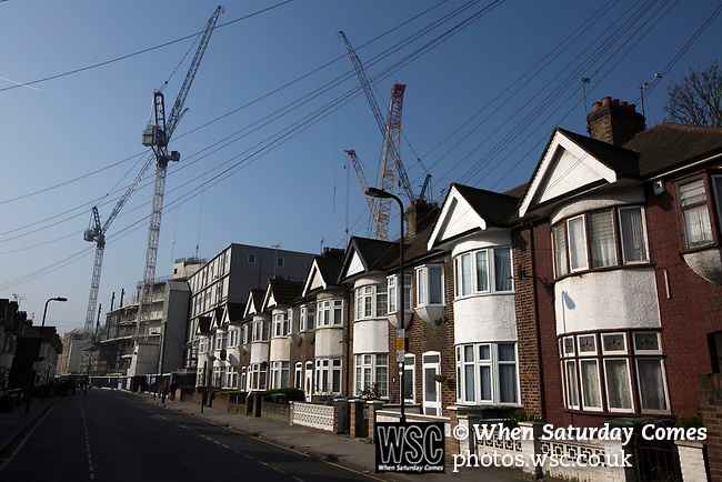 Tottenham Hotspur 4 Watford 0, 08/04/2017. White Hart Lane, Premier League. A row of houses on Worcester Avenue, with building work on the new stadium taking place behind it, pictured before Tottenham Hotspur took on Watford in an English Premier League match at White Hart Lane. Spurs were due to make an announcement in April 2016 regarding when they would move out of their historic home and relocate to Wembley as their new stadium was completed. Spurs won this match 4-0 watched by a crowd of 31,706, a reduced attendance figure due to the ongoing ground redevelopment. Photo by Colin McPherson.