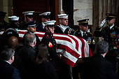 WASHINGTON, DC - DECEMBER 3 : Former president George H.W. Bush is carried in by Military Honor Guard as he arrives to lie in State at the U.S. Capitol Rotunda on Capitol Hill on Monday, Dec. 03, 2018 in Washington, DC. (Photo by Jabin Botsford/Pool)