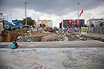 ISTANBUL, TURKEY: A man sits in front of the beginnings of development work in Istanbul's Taksim Square. Later that evening protestors were cleared from the square by police using tear gas and water cannon.<br /> <br /> Protests that began nearly three weeks ago to try and protect an Istanbul park from redevelopment have spread across Turkey and become an expression of wider discontent with the government of Prime Minister Recep Tayyip Erdogan.<br /> <br /> Photo by Kamaran Najm/Metrography