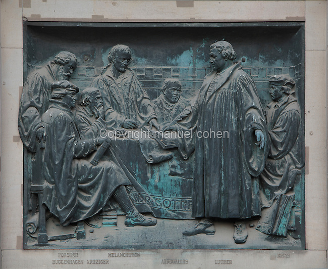 Luther and the reformers, bas-relief at the entrance to the Berliner Dom or Berlin Cathedral, redesigned by Julius Raschdorff and completed 1905 in Historicist style after being badly damaged in World War Two, although the original chapel on this site was consecrated in 1454, Museum Island, Mitte, Berlin, Germany. The buildings on Museum Island were listed as a UNESCO World Heritage Site in 1999. Picture by Manuel Cohen
