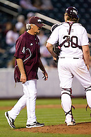 Assistant Coach Paul Evans (28) of the Missouri State Bears walks up to the mound during a game against the Purdue Boilermakers at Hammons Field on March 13, 2012 in Springfield, Missouri. (David Welker / Four Seam Images)