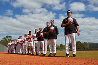 Illinois State Redbirds, including coaches (R-L) Bo Durkac, Mike Stalowy, Michael Kellar, and J. Golden, stand for the national anthem before a game against the Michigan State Spartans on March 8, 2016 at North Charlotte Regional Park in Port Charlotte, Florida.  Michigan State defeated Illinois State 15-0.  (Mike Janes/Four Seam Images)