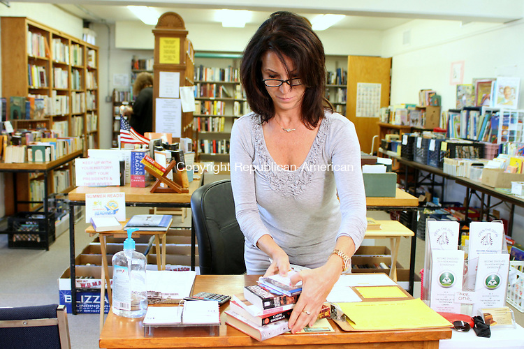 WATERTOWN, CT, 15 September 2015 - 091515HOLW01- Volunteer Deb Smolley sorts books at the Book Nook used book store on the lower level of the Watertown Library on Main Street Tuesday. Laraine Weschler