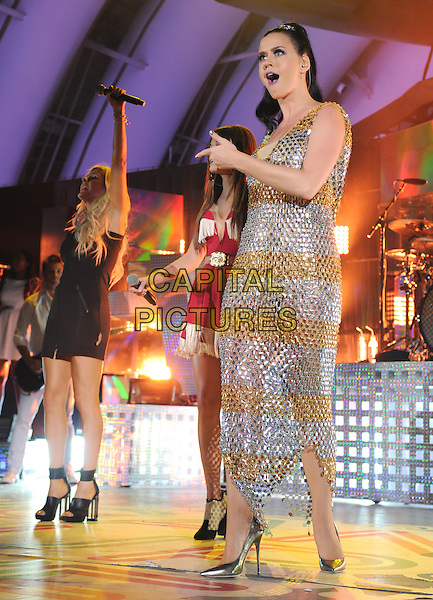 Ellie Goulding, Katy Perry<br /> performs at The Katy Perry's 'We Can Survive' benefit concert benefitting the Young Survival Coalition held at The Hollywood Bowl in Hollywood, California, USA.<br /> October 23rd, 2013<br /> on stage in concert live gig performance performing music full length gold silver metallic chainmail dress black hand arm finger pointing mouth open singing <br /> CAP/DVS<br /> &copy;DVS/Capital Pictures