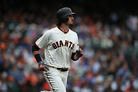 SAN FRANCISCO, CA - AUGUST 9:  Jarrett Parker #6 of the San Francisco Giants runs to first base against the Chicago Cubs during the game at AT&T Park on Wednesday, August 9, 2017 in San Francisco, California. (Photo by Brad Mangin)