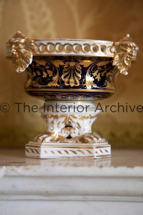 A tiny gilded urn in the drawing room