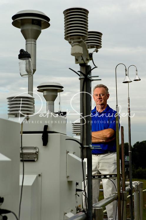 Mecklenburg County Air Monitoring Environmental Specialist David Hord at the Garinger High School monitor station in Charlotte, North Carolina.<br /> <br /> Charlotte Photographer - PatrickSchneiderPhoto.com