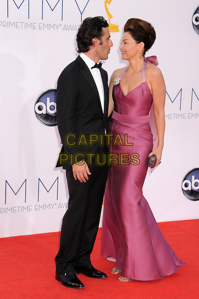 Dario Franchitti, Ashley Judd.The 64th Anual Primetime Emmy Awards - Arrivals, held at Nokia Theatre L.A. Live in Los Angeles, California, USA..September 23rd, 2012.emmys full length black tuxedo white shirt purple pink dress  married husband wife halterneck clutch bag hair up profile beehive .CAP/ADM/BP.©Byron Purvis/AdMedia/Capital Pictures.